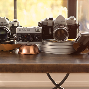 vintage cameras and film on a table