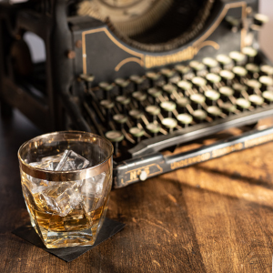 old fashioned typewriter and whiskey